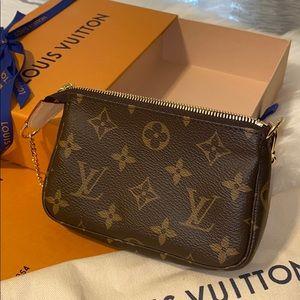 Authentic Louis Vuitton mini pouchette